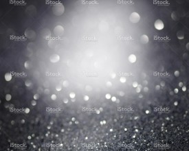 stock-photo-80666735-gray-glittering-christmas-lights-blurred-abstract-background